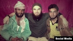 Chechen militant Abdulmalik Magomadov, aka Abu Umar Grozny, (center) is a member of the Islamic State's North Caucasus battalion Katibat al-Aqsa.