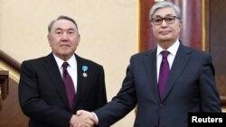 Нұрсұлтан Назарбаев (сол жақта) пен Қасым-Жомарт Тоқаев. Астана, 20 наурыз 2019 жыл.