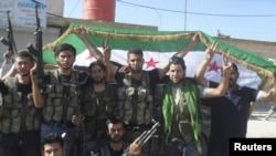 Members of the Free Syrian Army pose for the cameras in Azzaz, Aleppo province, on July 19.