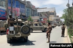 Afghan police arrive at the site of an attack in Kabul on May 12.