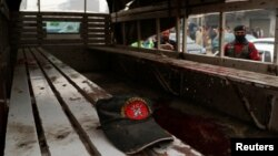 A hat remains on a bench after a blast killed three officers of the Frontier Constabulary in Peshawar on November 22.