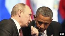 Russian President Vladimir Putin (left) and U.S. President Barack Obama confer at a G20 summit in 2012.