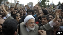 Mehdi Karrubi (center) has led calls for the complaints of the rape of prisoners detained in the demonstrations following the election to be investigated.