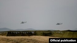 Nagorno-Karabakh - Armenian helicopter gunships fly during military exercises near the Line of Contact, 14Nov2014.