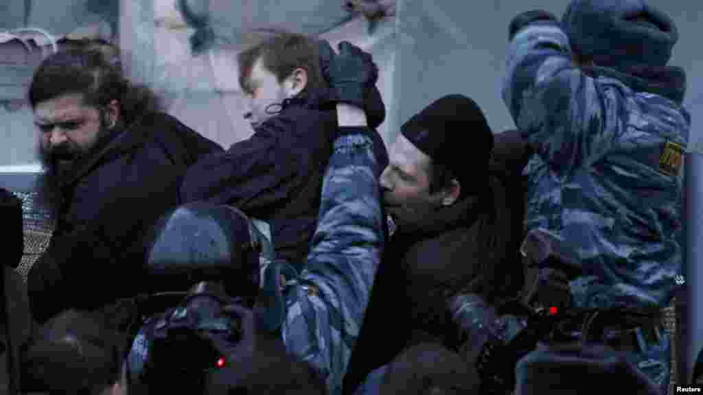 Russian police officers tussle with participants in an opposition rally in central Moscow on March 5. (Reuters/Tatyana Makeyeva)