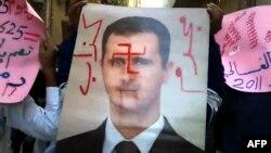 Сурия мухолифати Ассад кетишини истайди.