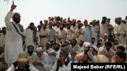 FILE: Residents of the town of Bara in the Khyber tribal district debate the fate of minority Sikhs threatened by a fanatical cleric in 2002.