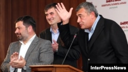 Georgian Party leaders Erosi Kitsmarishvili, Sozar Subari, and Levan Gachechiladze (left to right) announced the new bloc in Tbilisi on October 12.