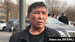 Nurzhan Mukhammedov attends a demonstration in front of the Shymkent city police department in December 2019.