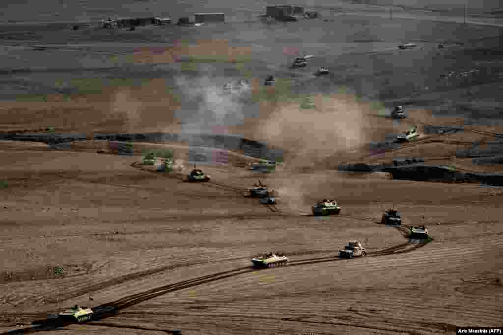 A convoy of Iraqi Army vehicles roll towards Mosul on February 27. The U.S.-backed, Iraqi-led coalition consists of approximately 100,000 troops and is the largest mobilization of Iraqi forces since the U.S. invasion of 2003.
