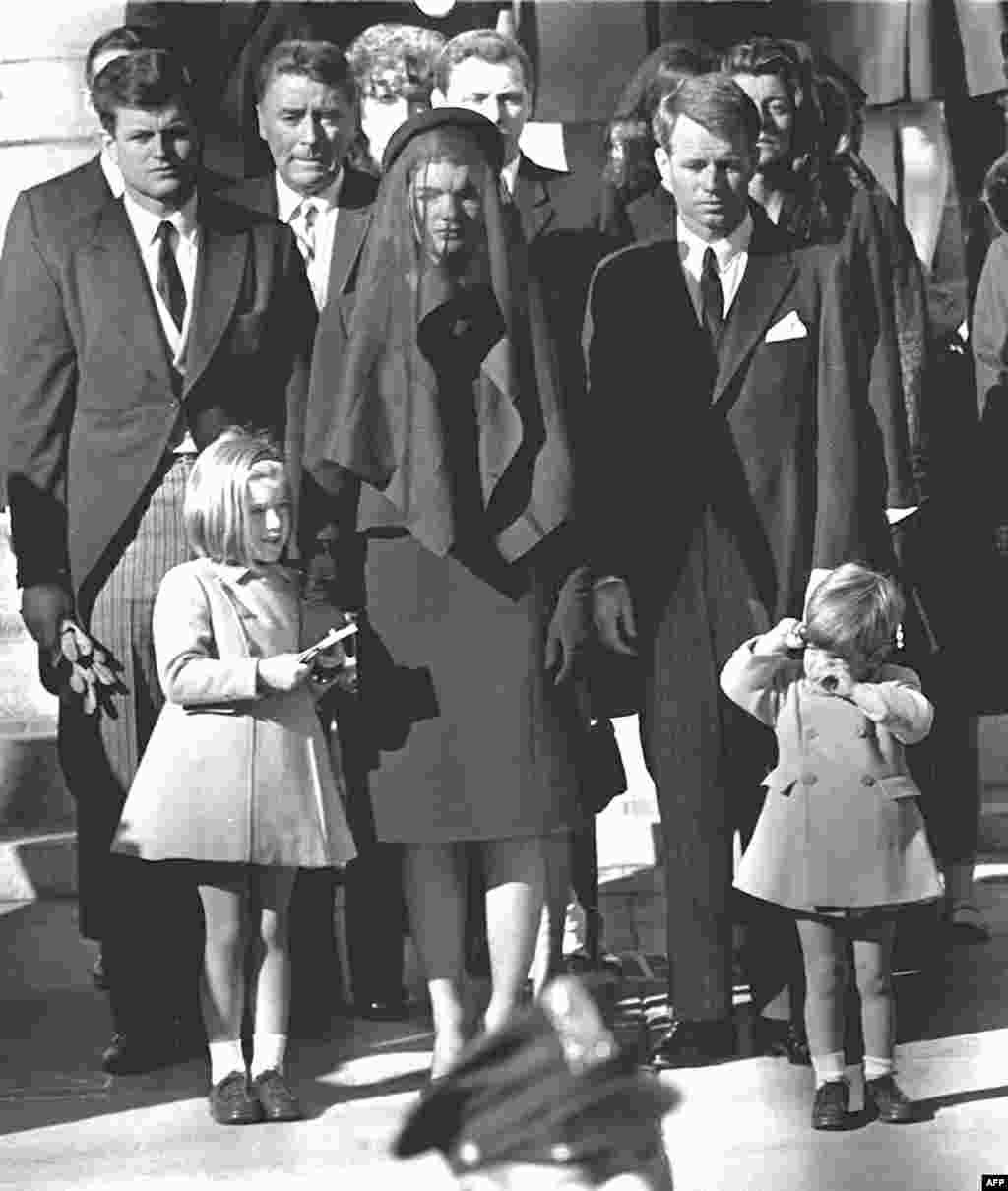 Jacqueline Kennedy stands with her two children, Caroline and John Jr., and brothers-in law Edward (Ted) (back left) and Robert (back right) at President Kennedy's funeral on November 26, 1963, in Washington, D.C.