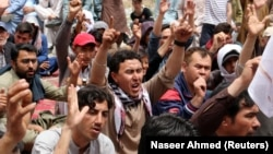 Family members and relatives chant slogans during a protest to condemn the April 12 attack on the Hazaras in Quetta's fruits and vegetable market.