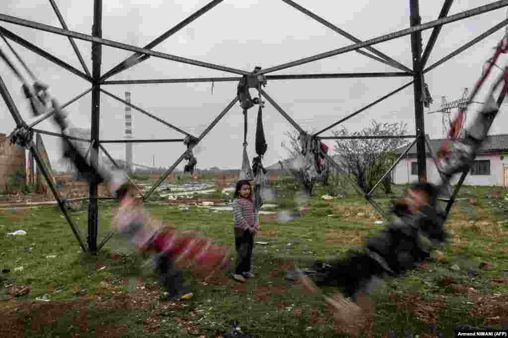 Roma children swing on tied clothes near their shelter at a camp in the village of Plemetina, Kosovo, on April 8, during International Roma Day celebrating Romany culture in Europe. (AFP/Armend Nimani)