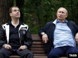 Are President Dmitry Medvedev (left) and Prime Minister Vladimir Putin engaged in political theater?