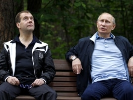 Are President Dmitry Medvedev (left) and Prime Minister Vladimir Putin engaged in political theater?