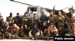 """Сирияда соғысып жүрген Қазақстандық """"жиһадшылар"""" деп, «ВКонтакте» әлеуметтік желісінде жарияланған видеодан скриншот."""