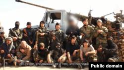 """Скриншот размещенного в социальной сети """"ВКонтакте"""" видео, в котором рассказывается о казахстанцах, сражающихся в Сирии."""