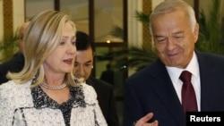 Uzbek President Islam Karimov (right) greets U.S. Secretary of State Hillary Clinton in Tashkent.
