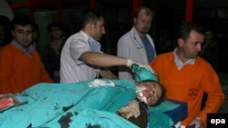 A wounded woman is taken to the hospital in Diyarbakir early on May 5.