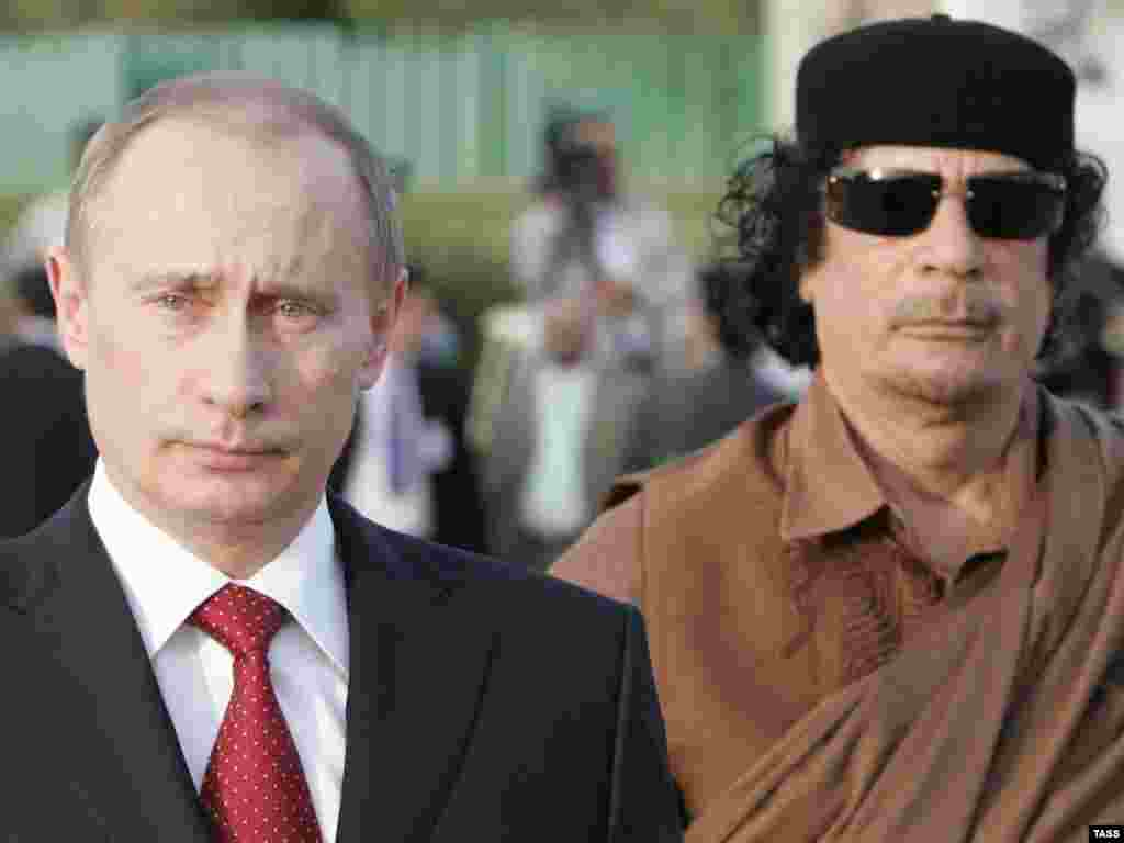 Russian President Vladimir Putin holds talks with Qaddafi at Qaddafi's residence within the Bab al-Aziziya barracks in Tripoli in April 2008.