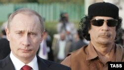 Then Russian President Vladimir Putin (left) and Libyan leader Muammar Qaddafi at Qaddafi's residence within the Bab al-Aziziya barracks in Tripoli in April 2008