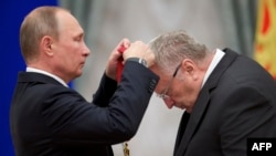 Russian President Vladimir Putin (left) awards lawmaker Vladimir Zhirinovsky during a ceremony at the Kremlin in Moscow in September.