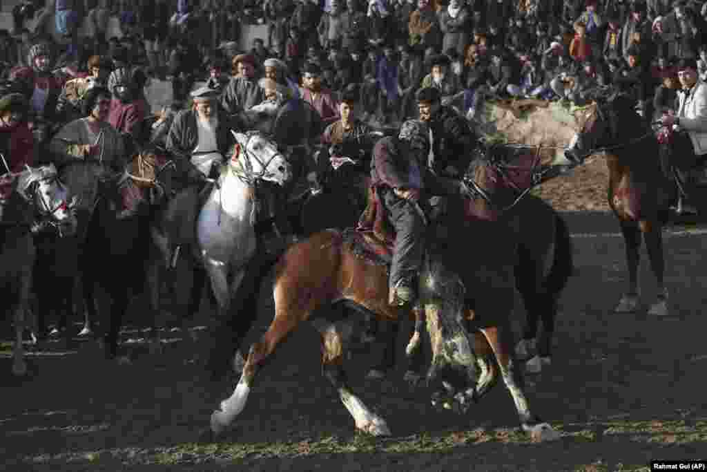 Afghan horsemen compete for the goat during a friendly buzkashi match on the outskirts of Kabul. (AP/Rahmat Gul)