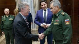 U.S. national-security adviser John Bolton (left) meets with Russian Defense Minister Sergei Shoigu in Moscow on October 23.