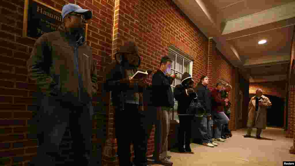 Voters stand in line before the polls open at Harrison United Methodist Church in Pineville, North Carolina.