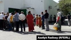 Ashgabat residents queue for food earlier this month.