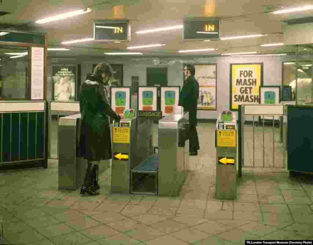 Passengers go through an automatic ticket gate at the Seven Sisters Station in 1969.
