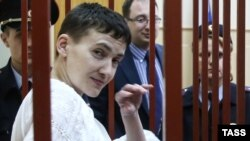 Ukrainian military pilot Nadia Savchenko stands inside a defendants' cage as she attends a court hearing in Moscow on April 17.