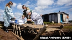 Residents of a remote Khanty cattle camp take part in early voting on the constitutional amendments on June 25.