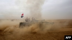 An Iraqi forces tank advances south of Mosul