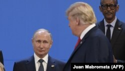 U.S. President Donald Trump (right) looks at Russian President Vladimir Putin as they take their places for a photo during the Group of 20 summit in Buenos Aires in 2018.
