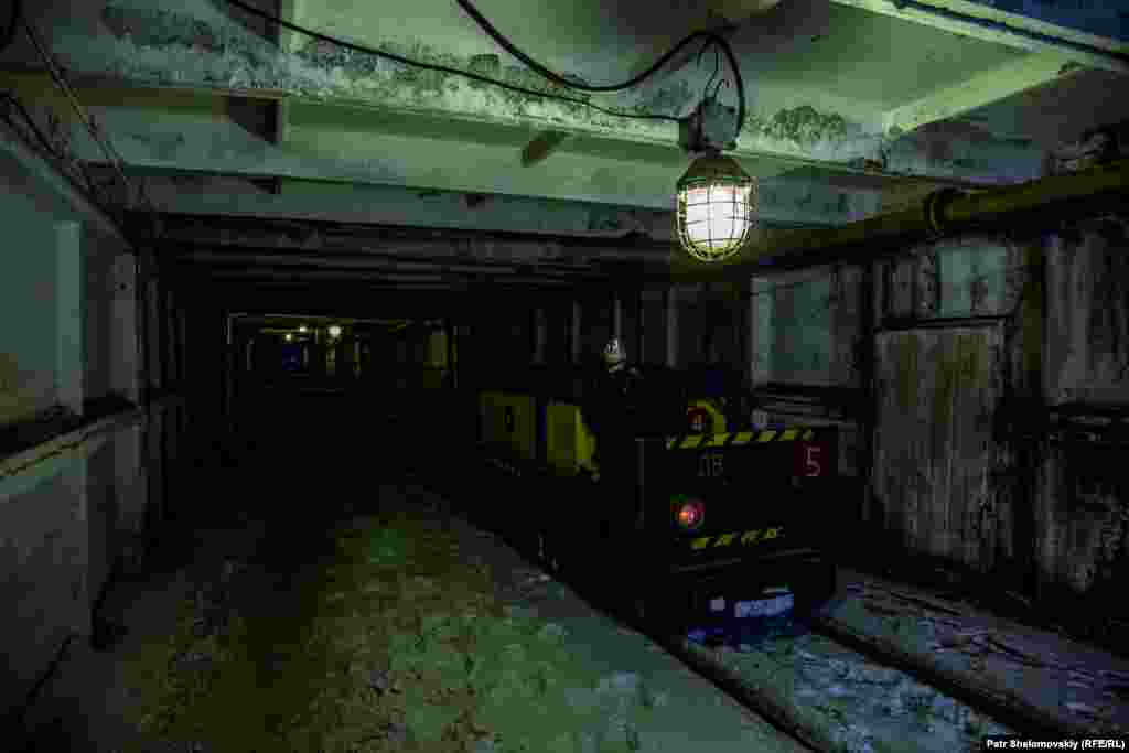 An electric carriage used to transport coal in the Severnaya coal mine lies idle in one of its tunnels.