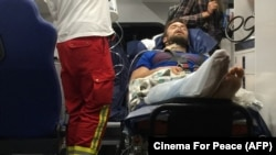 Verzilov is seen in an ambulance after arriving in Berlin for treatment on September 15.