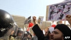 Protesters holding up anti-Saudi signs rally in front of the Saudi Embassy in Tehran in March, following Saudi assistance to a crackdown on Shi'ite protesters in Bahrain. Could sectarian tensions be raised as part of a Saudi-Iran proxy clash?