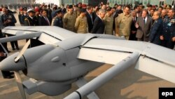 Prime Minister Nawaz Sharif (3-R) looks at Pakistani-made 'Burraq' drone during a ceremony in 2013.