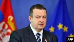 Serbian Prime Minister Ivica Dacic gives a press conference following a working session at EU headquarters in Brussels on June 26.