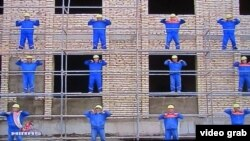 Construction workers take part in Turkmenistan's state-ordered Week of Health and Happiness in this video grab from Turkmen state television.
