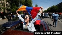 ARMENIA -- A woman reacts during a rally held by supporters of Armenian opposition leader Nikol Pashinian in Yerevan, April 25, 2018