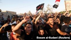 People gather during a protest near the government office in Basra on September 6.