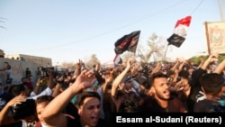 People gather during a protest near the building of government office in Basra, Iraq September 6, 2018.