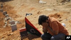 A Libyan man mourns a rebel fighter killed during recent fighting with forces loyal to Muammar Qaddafi near Brega in rebel-held Benghazi on July 17.