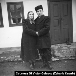 Sergiu Cebotari (right) with his wife, Ioana -- the photographer's daughter -- in front of the Cusnir house