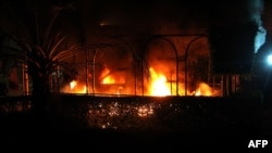 A vehicle burns after it was set on fire inside the U.S. Consulate compound in Benghazi, Libya, on September 11.