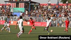 Players compete during a friendly soccer match between Afghanistan and Pakistan in Kabul in August 2013.
