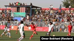FILE: Players compete during a friendly soccer match between Afghanistan and Pakistan in Kabul in August 2013.