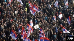 Supporters of the Serbian opposition wave flags during a mass protest in downtown Belgrade on February 5.